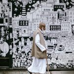 Black and white wall mural and man in ethnic clothing